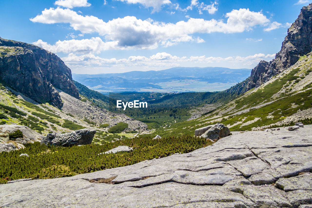 mountain, scenics - nature, beauty in nature, sky, cloud - sky, tranquil scene, tranquility, landscape, environment, mountain range, non-urban scene, nature, idyllic, day, rock, solid, remote, rock - object, no people, plant, outdoors, mountain peak