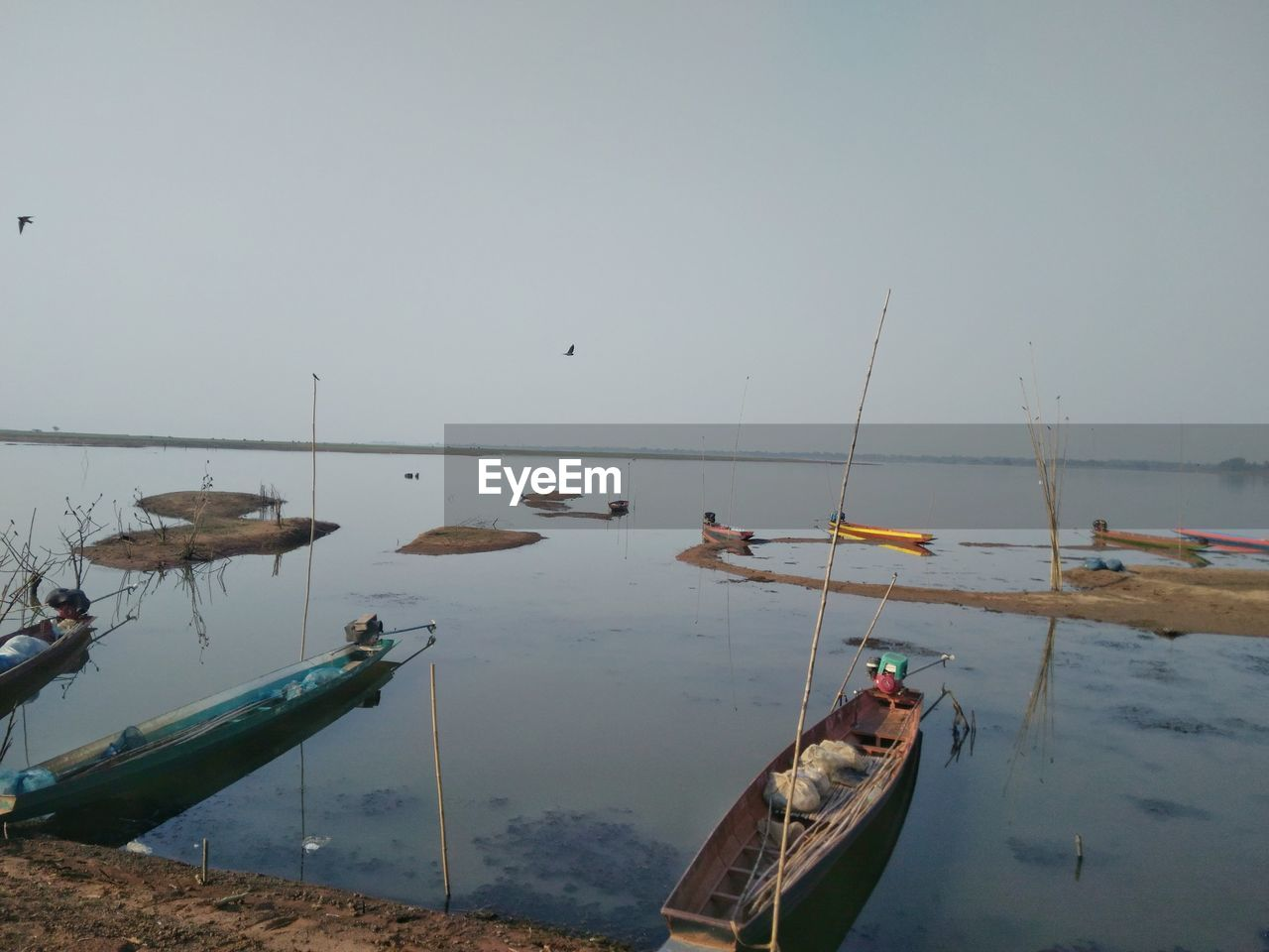 nautical vessel, transportation, water, mode of transportation, moored, sky, nature, sea, no people, day, copy space, scenics - nature, tranquility, clear sky, outdoors, beauty in nature, non-urban scene, horizon over water, fishing boat, fishing industry, rowboat