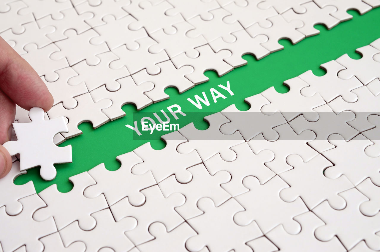 jigsaw piece, jigsaw puzzle, puzzle, solution, indoors, connection, pattern, leisure activity, green color, leisure games, full frame, no people, incomplete, strategy, large group of objects, backgrounds, relaxation, close-up, cooperation, complexity