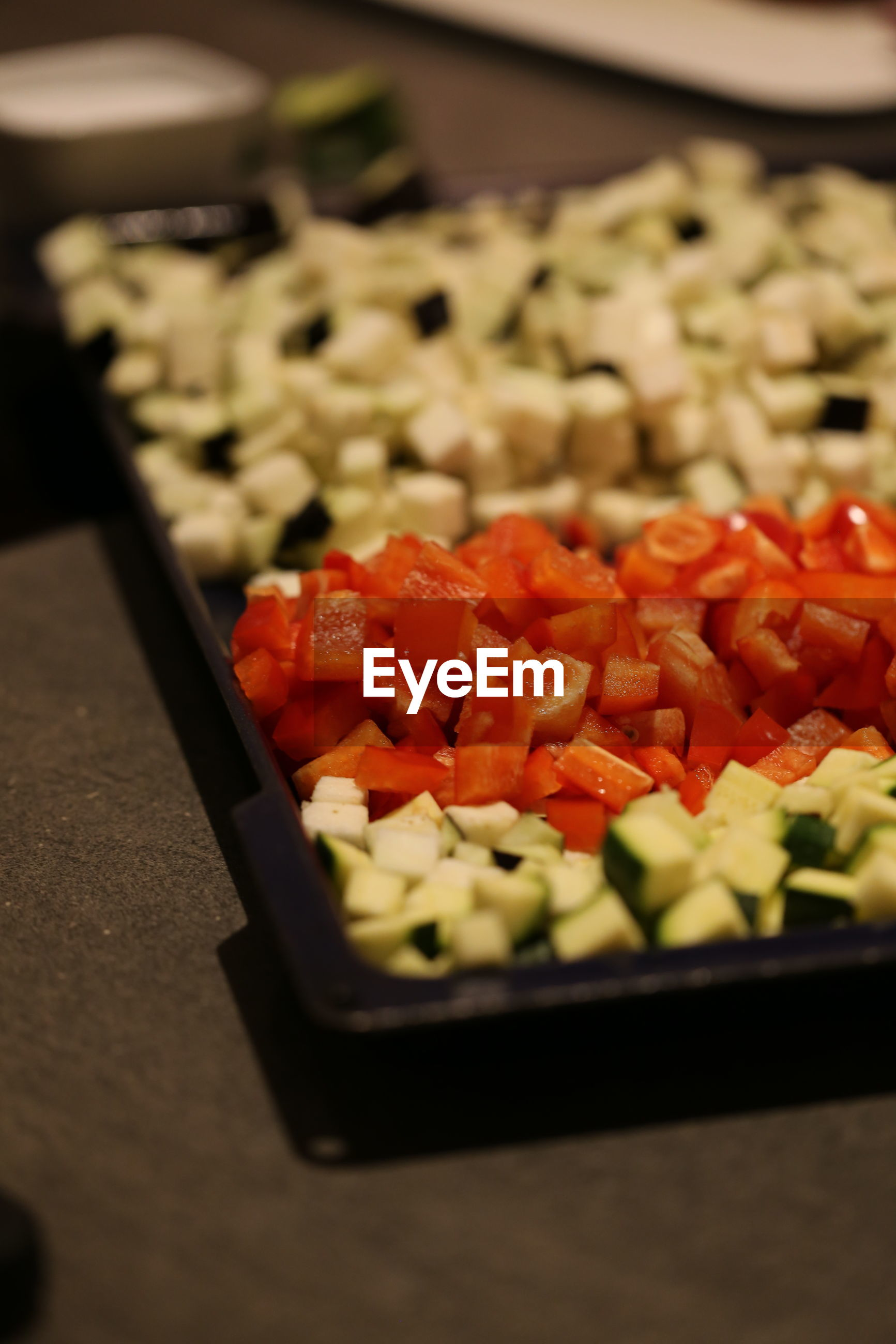 Close-up of chopped vegetables in tray on table