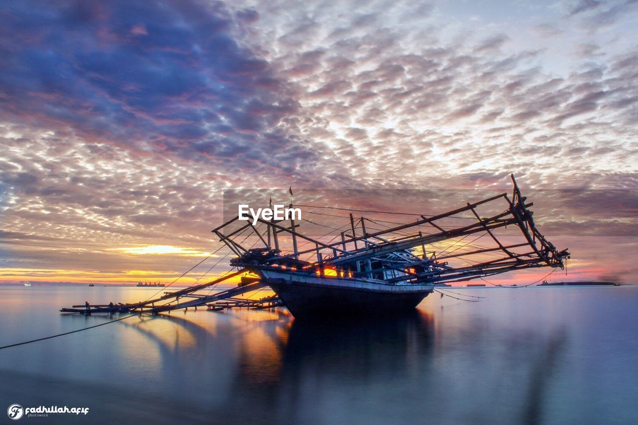 sunset, water, sky, cloud - sky, reflection, nature, nautical vessel, tranquility, beauty in nature, sea, scenics, transportation, no people, outdoors, moored, day