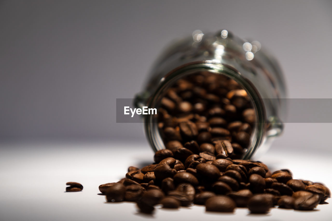 roasted coffee bean, food and drink, indoors, coffee - drink, still life, coffee, food, brown, container, close-up, coffee bean, roasted, jar, freshness, large group of objects, table, caffeine, selective focus, no people, drink