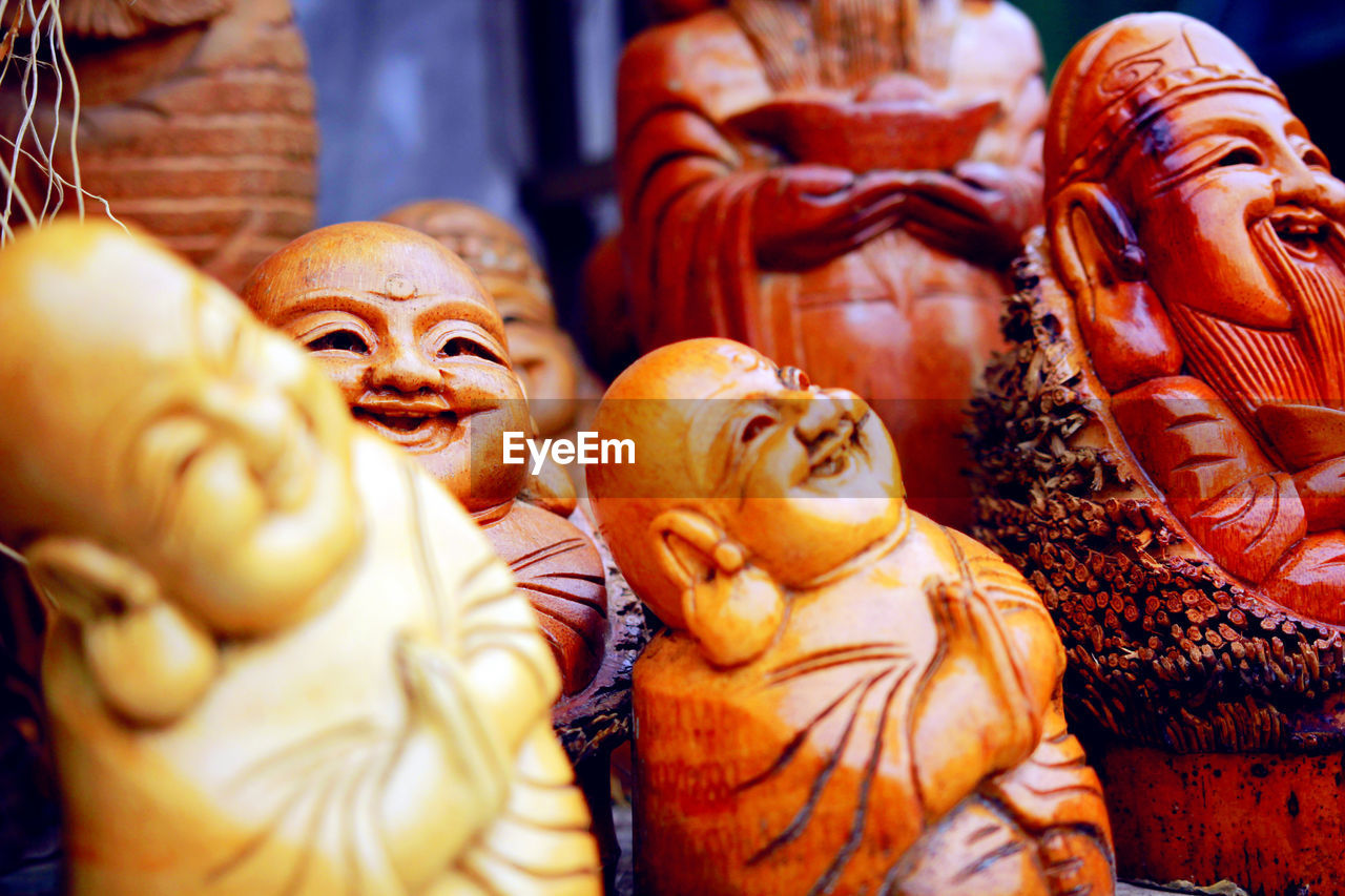 Close-Up Of Wooden Sculptures At Store