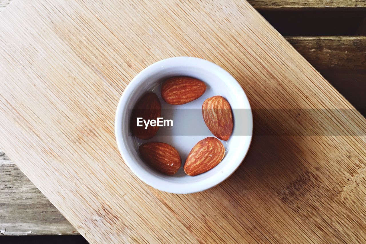Close-up high angle view of almonds on table