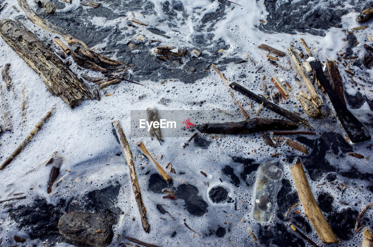 High Angle View Of Sticks In Sea