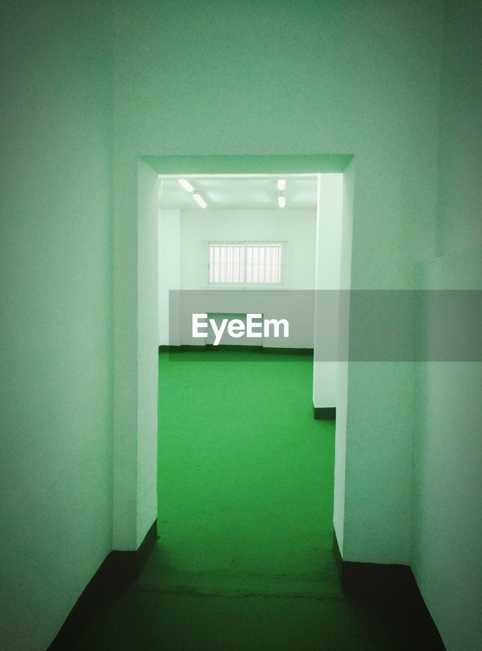 indoors, empty, door, green color, no people, corridor, illuminated, architecture, day