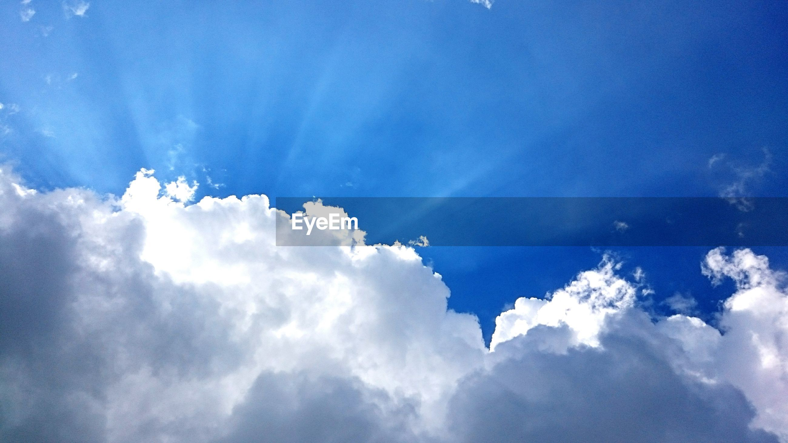low angle view, blue, sky, cloud - sky, sky only, beauty in nature, nature, tranquility, scenics, cloud, cloudscape, backgrounds, cloudy, outdoors, day, no people, tranquil scene, idyllic, high section, majestic