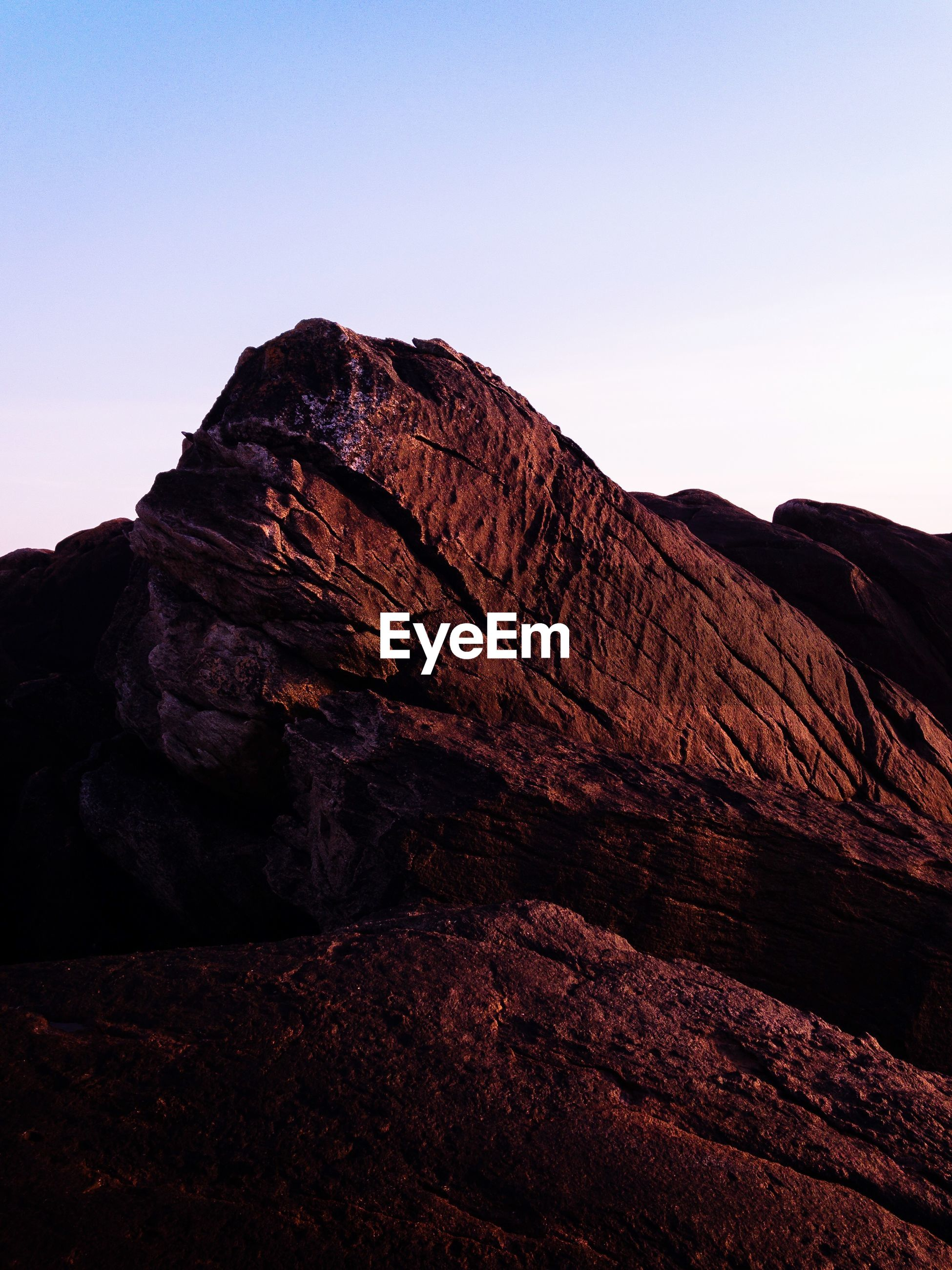 sky, rock, mountain, beauty in nature, tranquility, tranquil scene, scenics - nature, clear sky, rock - object, solid, no people, nature, non-urban scene, copy space, physical geography, geology, rock formation, environment, landscape, idyllic, outdoors, formation, arid climate, eroded, mountain peak