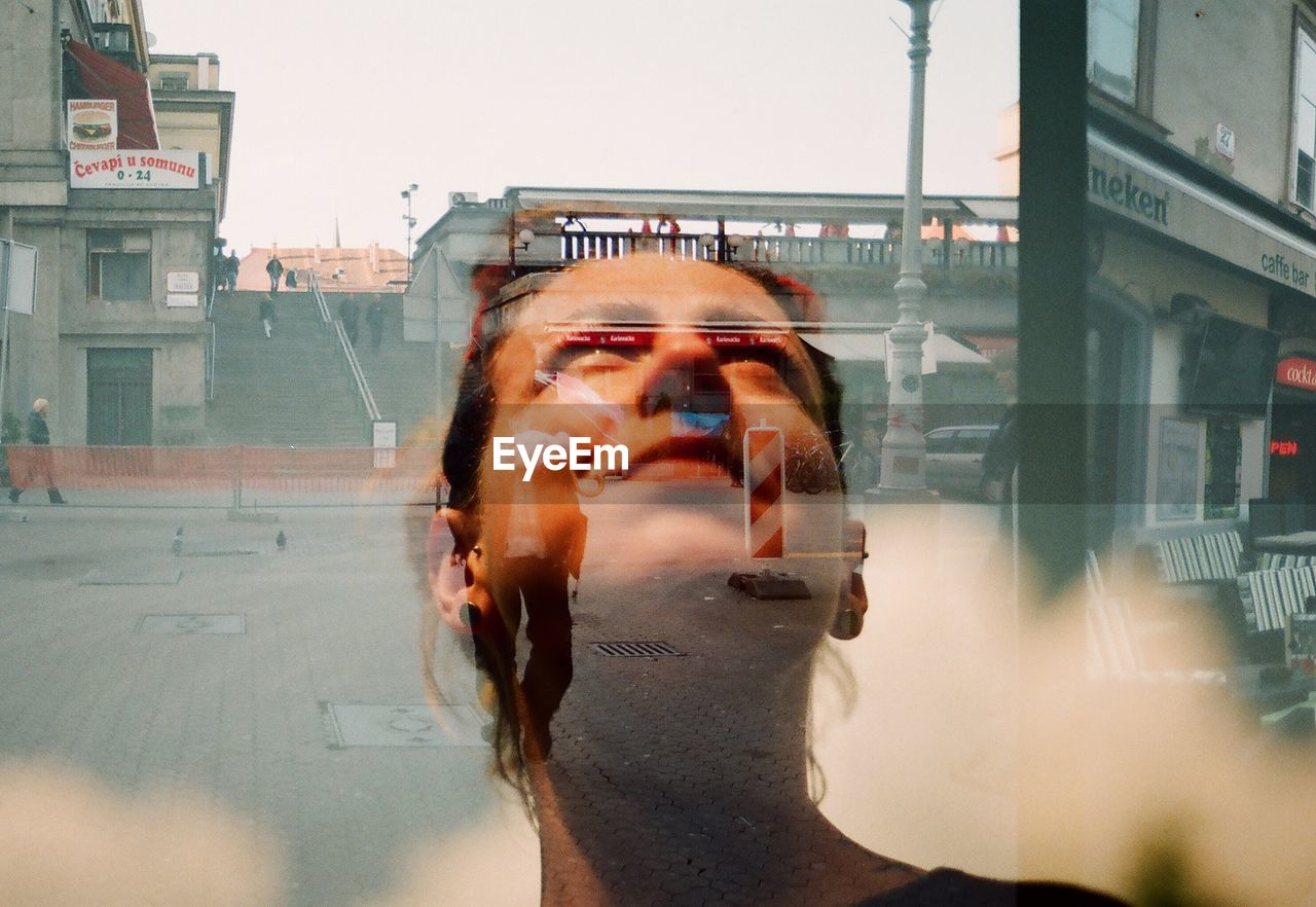 one person, real people, building exterior, glass - material, architecture, portrait, lifestyles, built structure, city, headshot, reflection, transparent, leisure activity, transportation, motion, photography themes, young adult, day, outdoors, human face, digital composite
