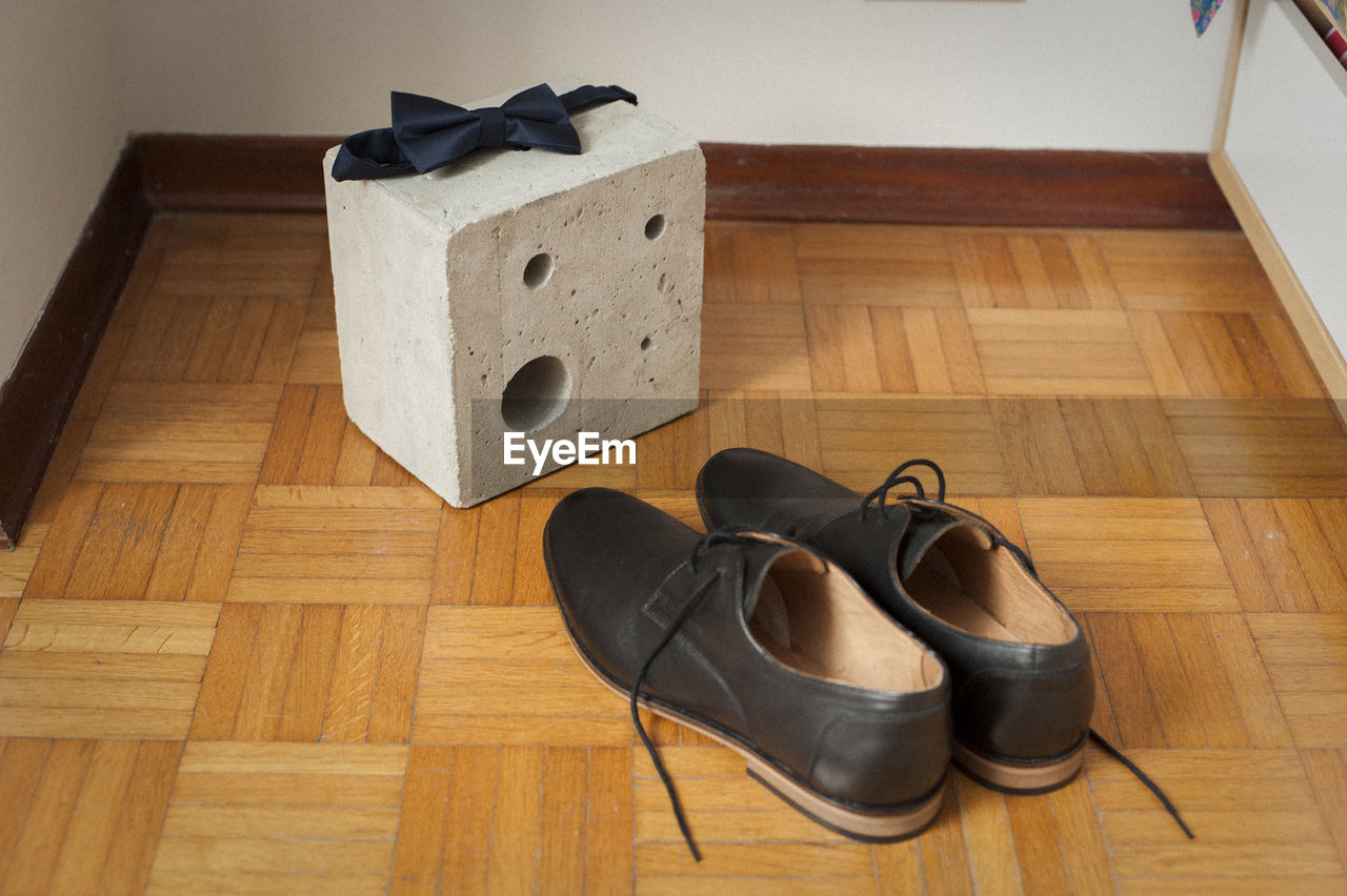High angle view of shoes on hardwood floor at home
