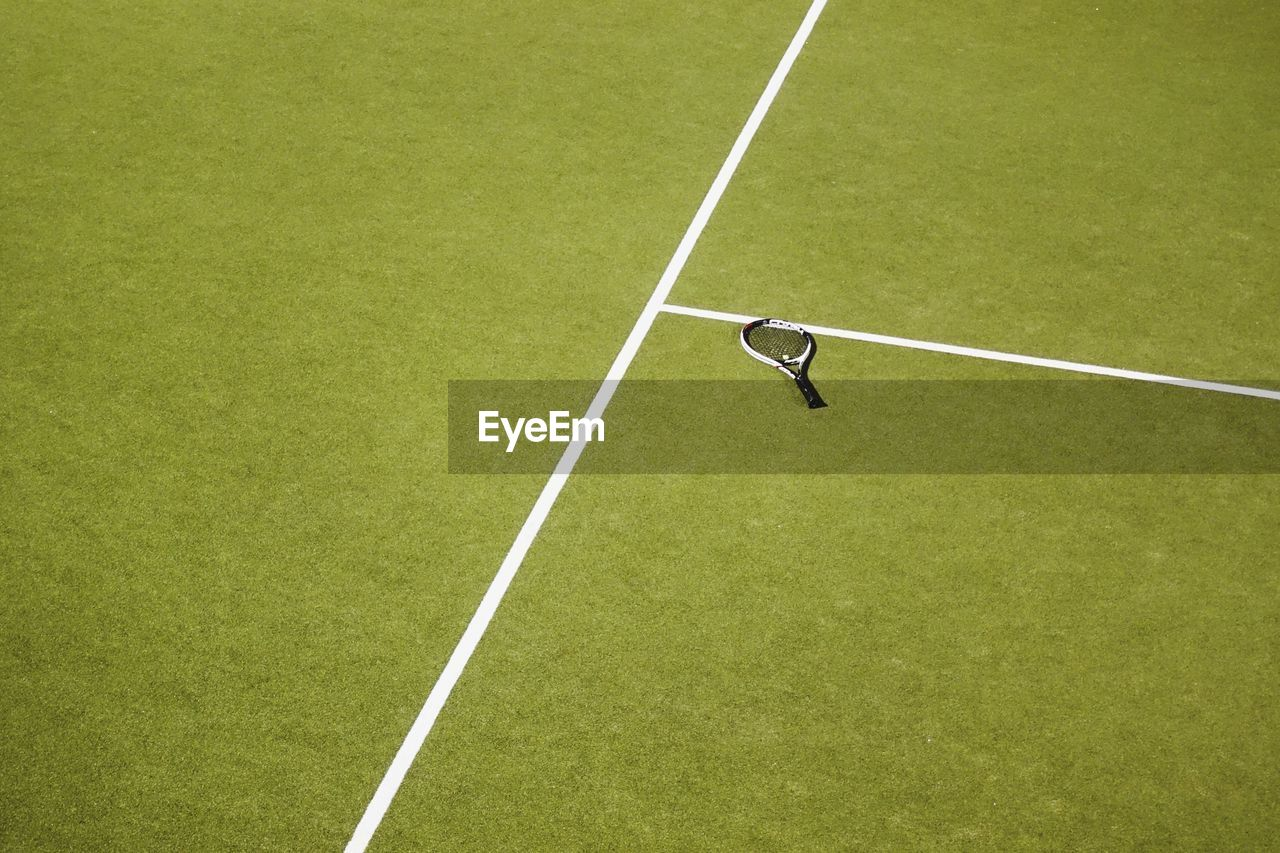 High angle view of tennis racket on court