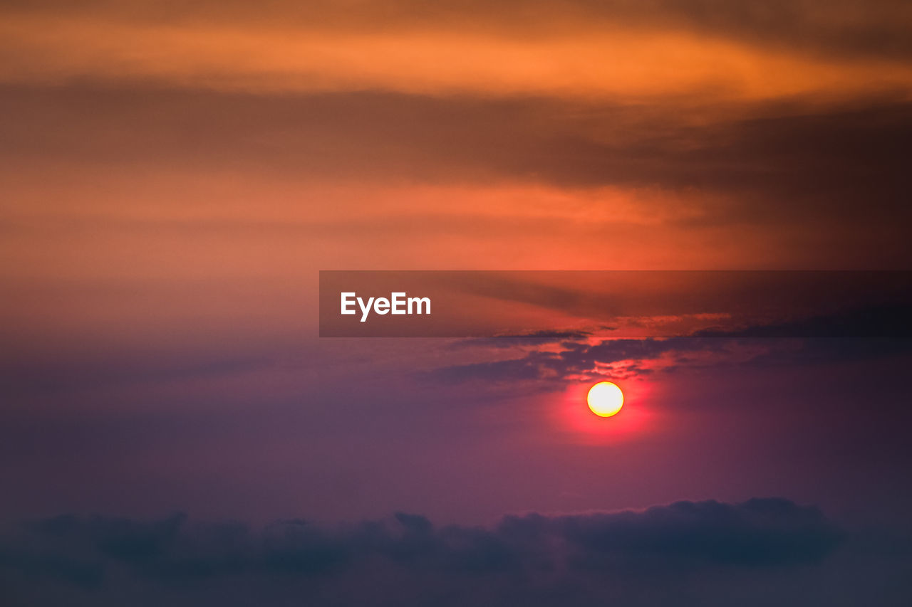 sky, beauty in nature, scenics - nature, sunset, cloud - sky, tranquil scene, tranquility, orange color, idyllic, sun, nature, no people, outdoors, space, non-urban scene, dramatic sky, astronomy, majestic, circle, moon, eclipse, romantic sky