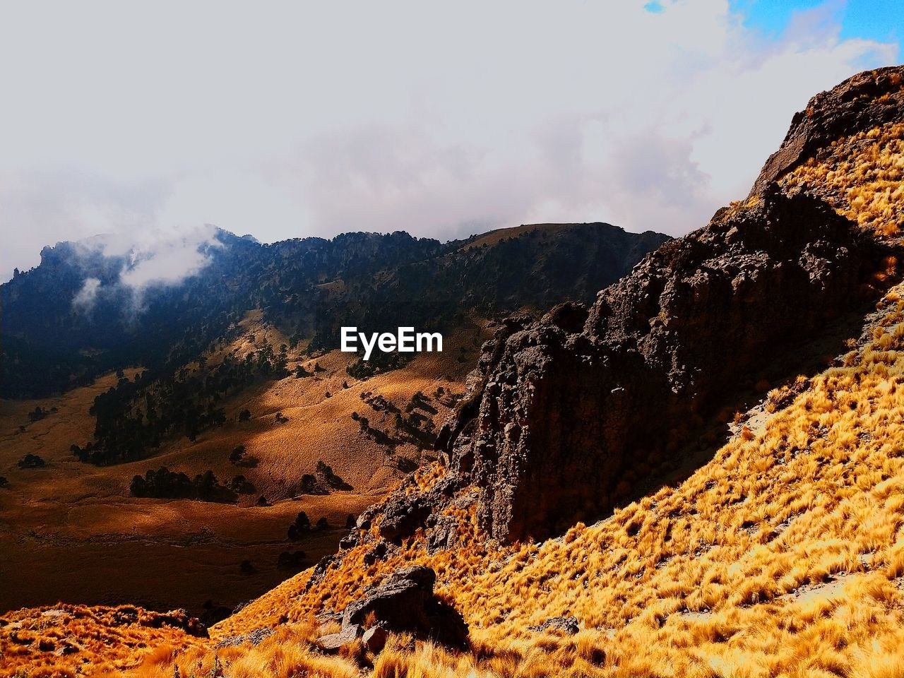 mountain, beauty in nature, sky, scenics - nature, tranquil scene, tranquility, cloud - sky, rock, nature, no people, non-urban scene, environment, mountain range, day, landscape, rock formation, solid, rock - object, land, physical geography, outdoors, formation, climate, arid climate, eroded, mountain peak
