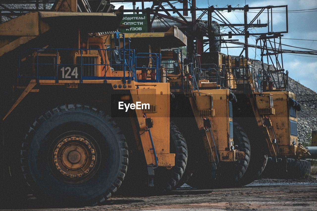 industry, construction industry, transportation, machinery, mode of transportation, no people, land vehicle, construction site, construction machinery, day, development, metal, architecture, outdoors, construction equipment, city, tire, nature, wheel, factory, industrial equipment