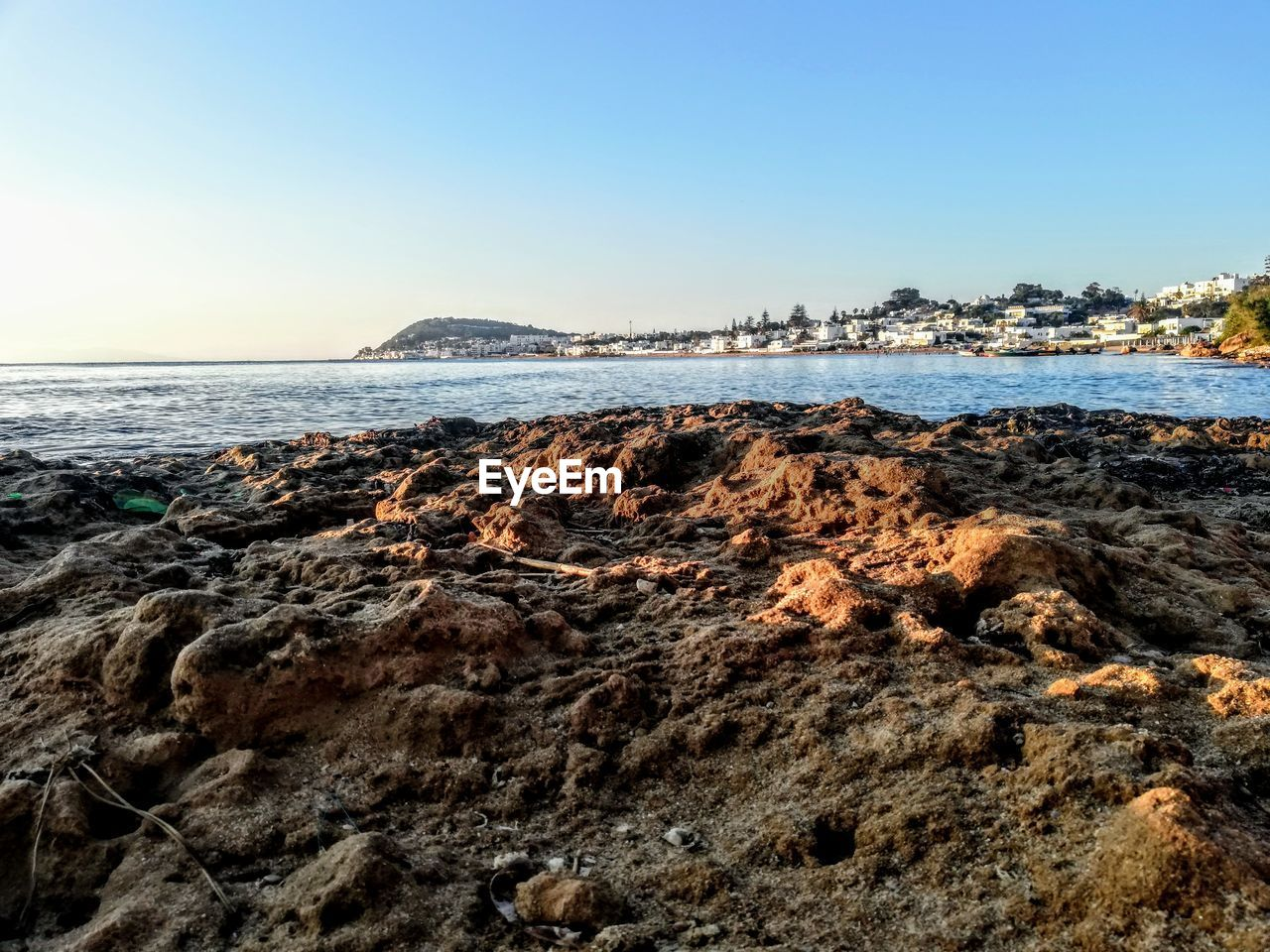 sea, sky, water, beach, rock, scenics - nature, land, rock - object, beauty in nature, clear sky, solid, nature, copy space, no people, tranquility, tranquil scene, horizon over water, horizon, rock formation, outdoors, rocky coastline