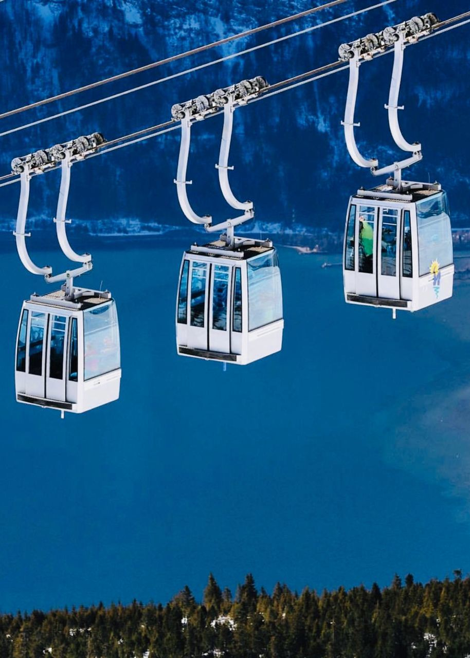 mode of transportation, nature, transportation, blue, cable car, sky, day, plant, hanging, ski lift, tree, travel, no people, public transportation, outdoors, overhead cable car, low angle view, nautical vessel, beauty in nature