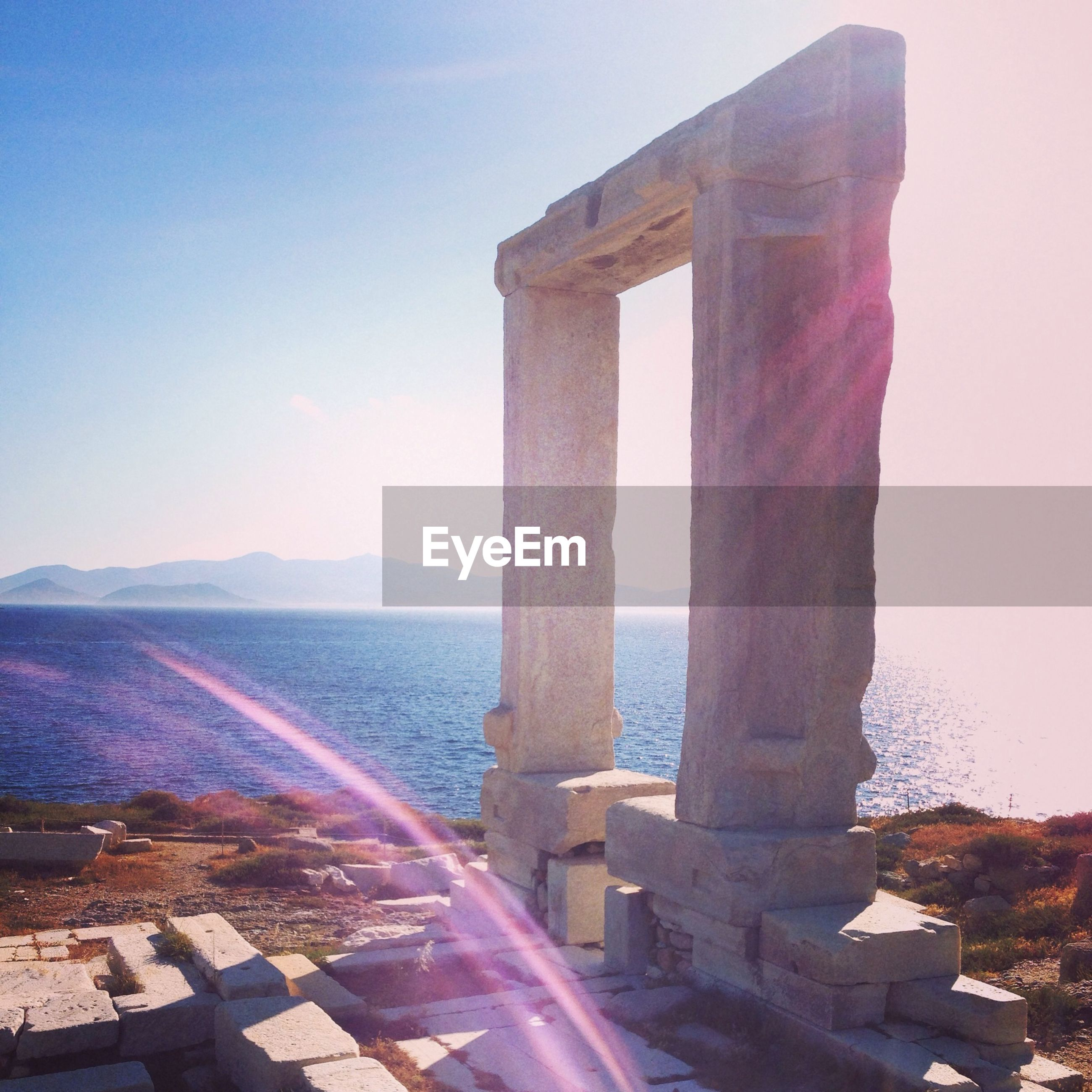 Temple of apollo against sea and sky on sunny day