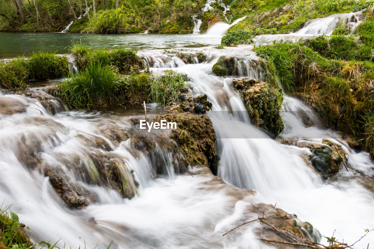 water, scenics - nature, beauty in nature, flowing water, waterfall, long exposure, motion, blurred motion, forest, tree, plant, rock, no people, solid, flowing, nature, rock - object, environment, land, outdoors, stream - flowing water, power in nature, rainforest, falling water