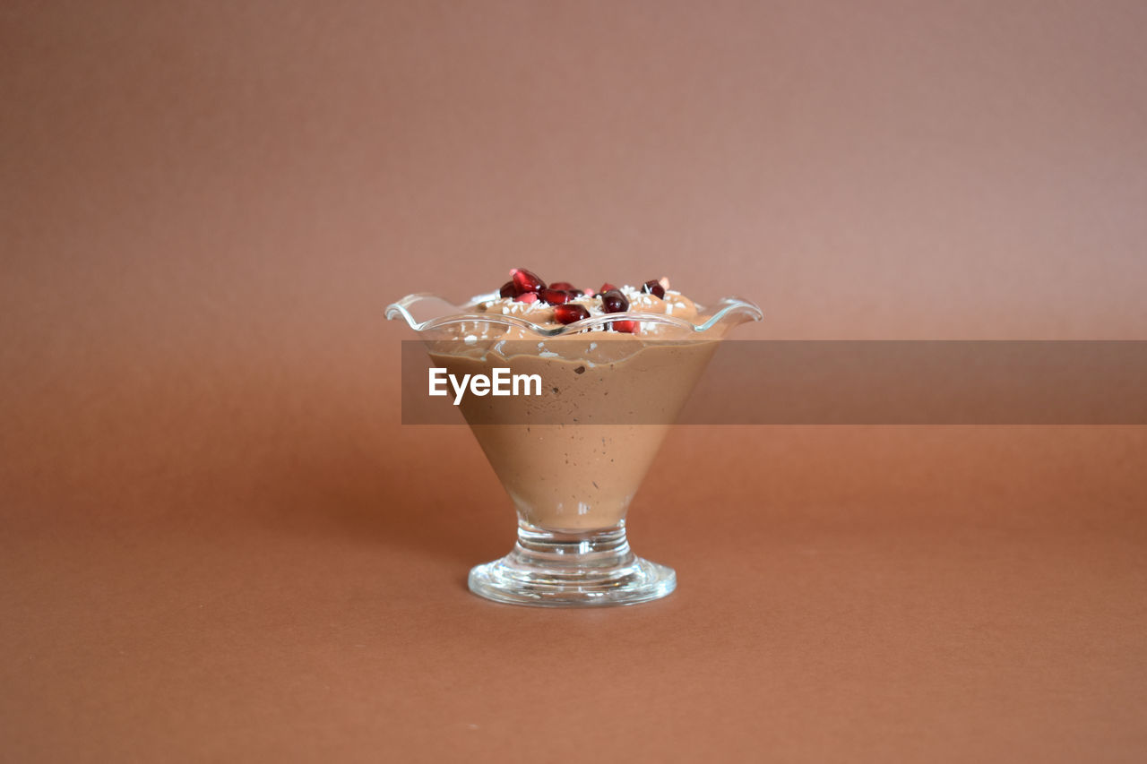 food, food and drink, still life, indoors, indulgence, freshness, no people, close-up, table, studio shot, sweet, temptation, sweet food, dessert, copy space, fruit, ready-to-eat, colored background, healthy eating, wellbeing, glass