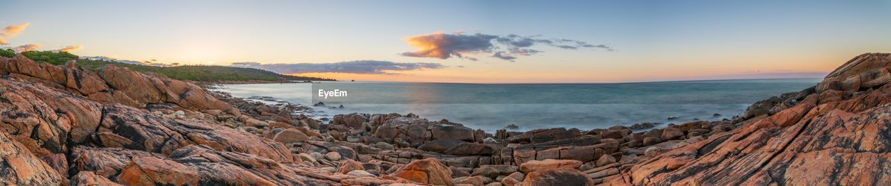 sky, sea, scenics - nature, sunset, water, rock, beauty in nature, tranquility, solid, tranquil scene, rock - object, no people, land, nature, beach, cloud - sky, horizon over water, orange color, non-urban scene, outdoors