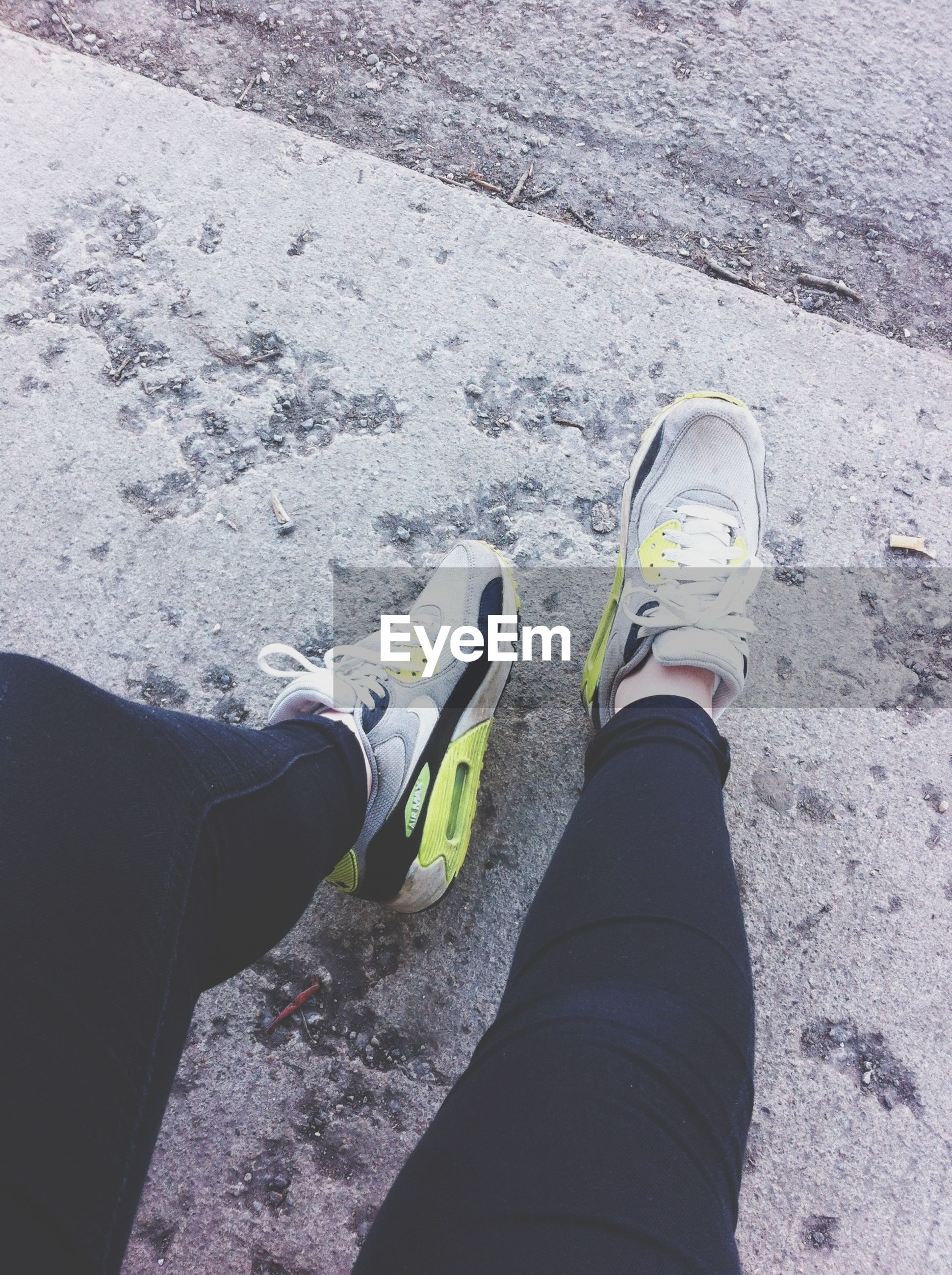 low section, person, shoe, personal perspective, footwear, human foot, high angle view, jeans, standing, street, lifestyles, men, part of, unrecognizable person, road, canvas shoe, leisure activity