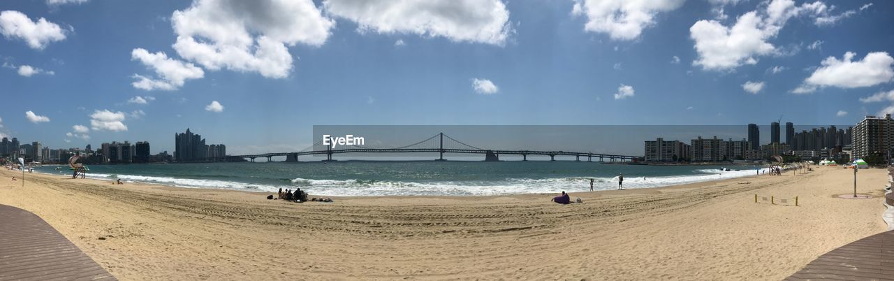 water, sky, beach, built structure, architecture, sea, cloud - sky, land, building exterior, sand, nature, city, day, tourism, travel destinations, incidental people, outdoors, travel, transportation, bay, office building exterior