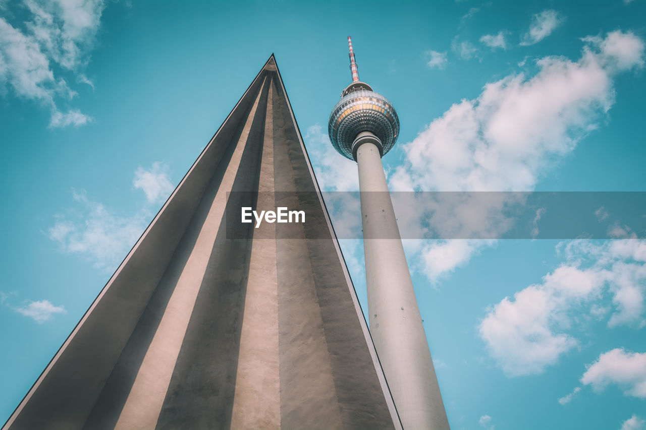 Low angle view of fernsehturm by triangle shape against sky