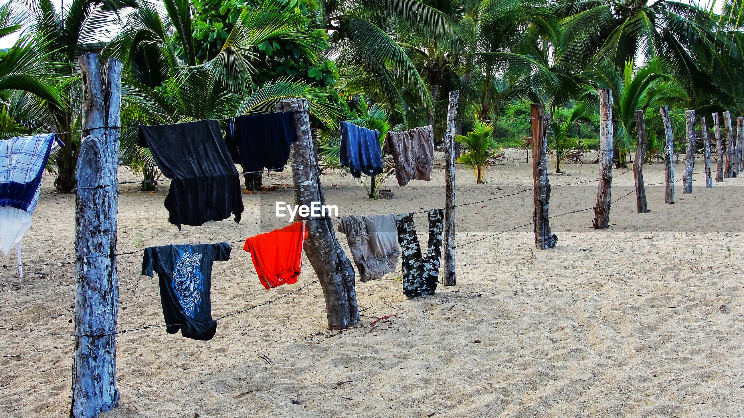 CLOTHES DRYING ON WOODEN POST