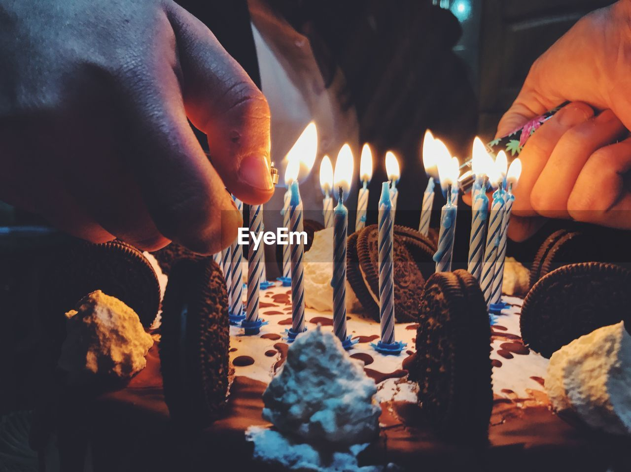 human hand, human body part, flame, burning, candle, human finger, celebration, birthday cake, birthday candles, indoors, one person, real people, holding, unrecognizable person, sweet food, heat - temperature, birthday, cake, lifestyles, leisure activity, temptation, dessert, life events, food, men, close-up, night, people, adult