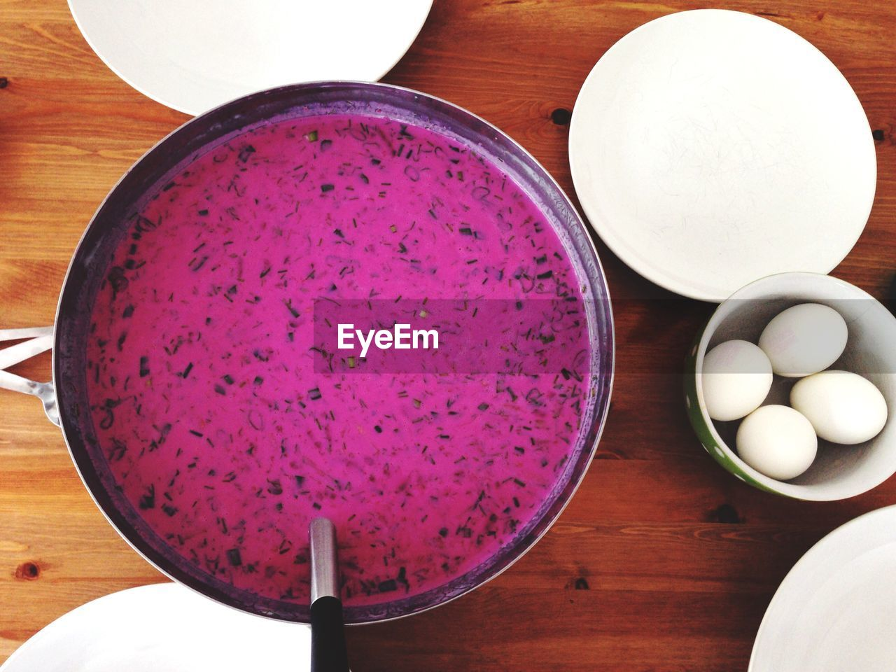 High angle view of beetroot soup served in cooking pan on table
