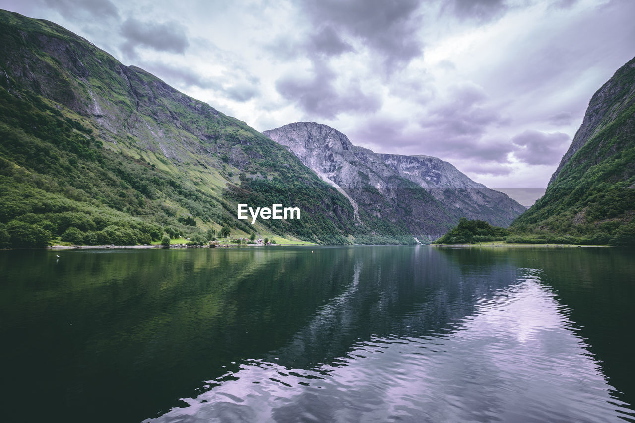 water, mountain, scenics - nature, beauty in nature, sky, cloud - sky, lake, tranquil scene, tranquility, mountain range, reflection, nature, no people, day, waterfront, non-urban scene, idyllic, outdoors, environment