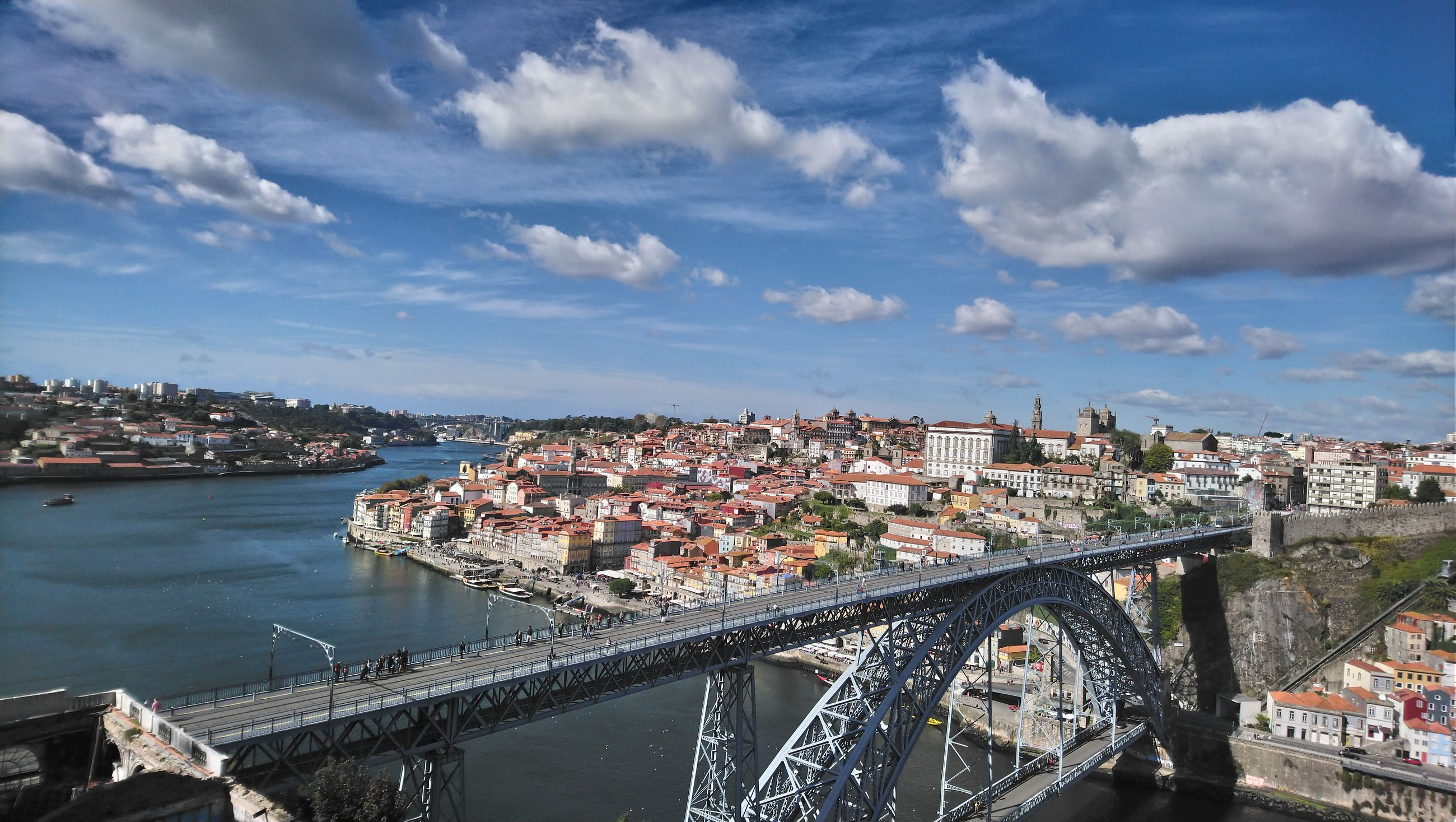 Aerial view of bridge over river by buildings in city