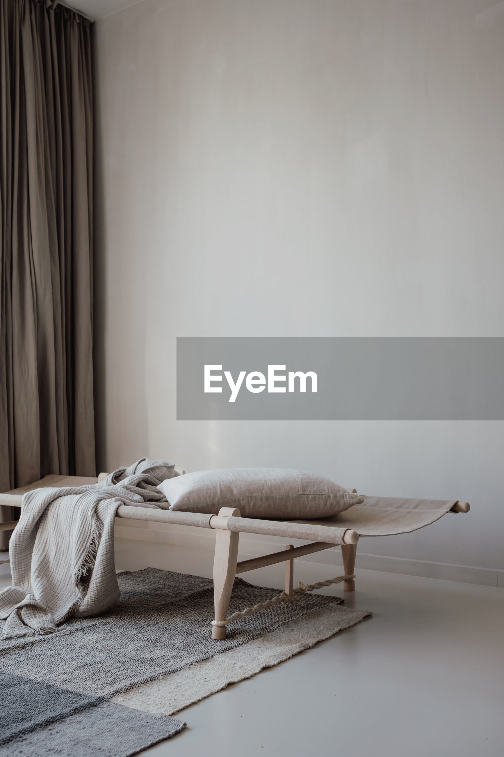 EMPTY CHAIRS AND TABLE ON BED AT HOME