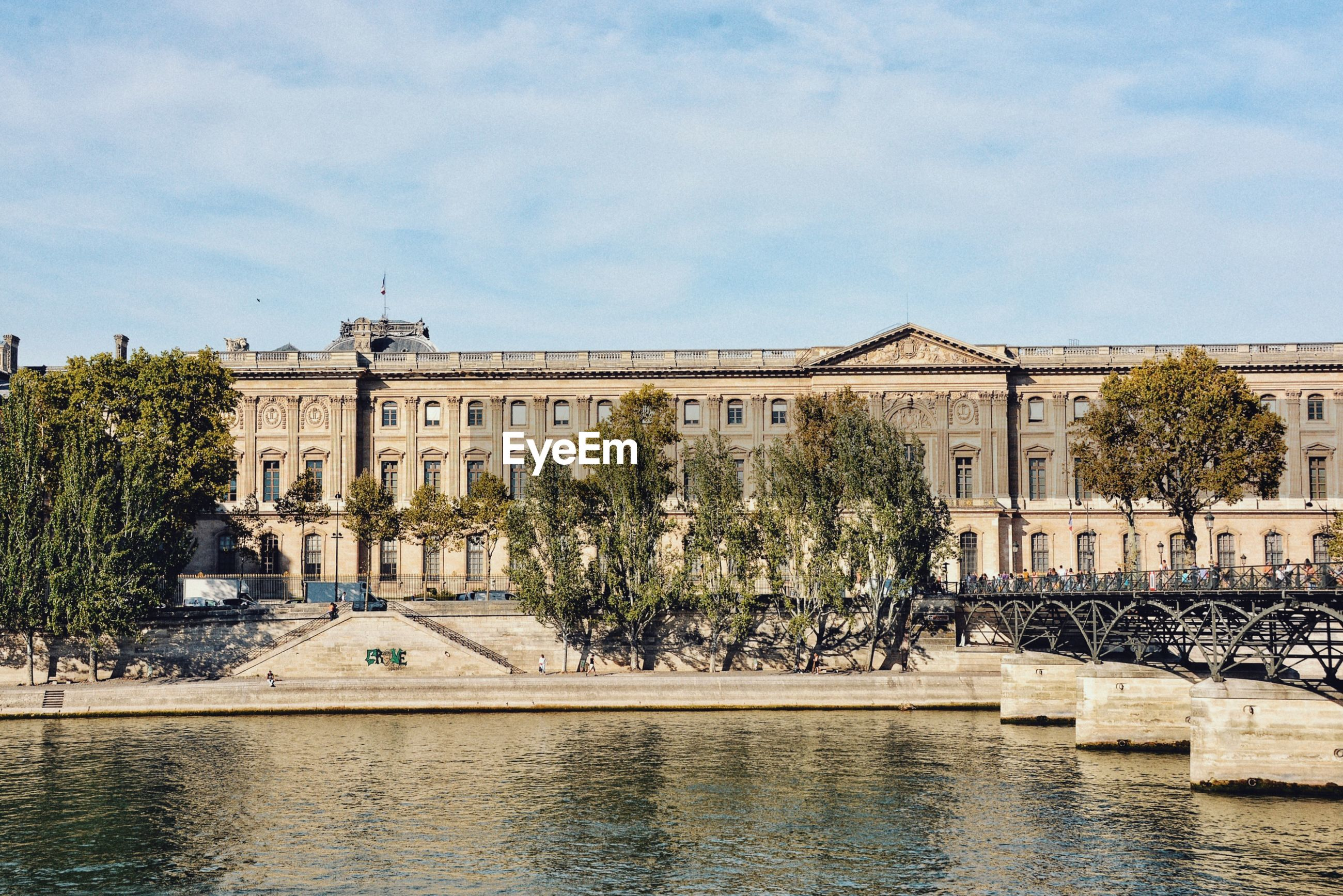 Pond against buildings in city