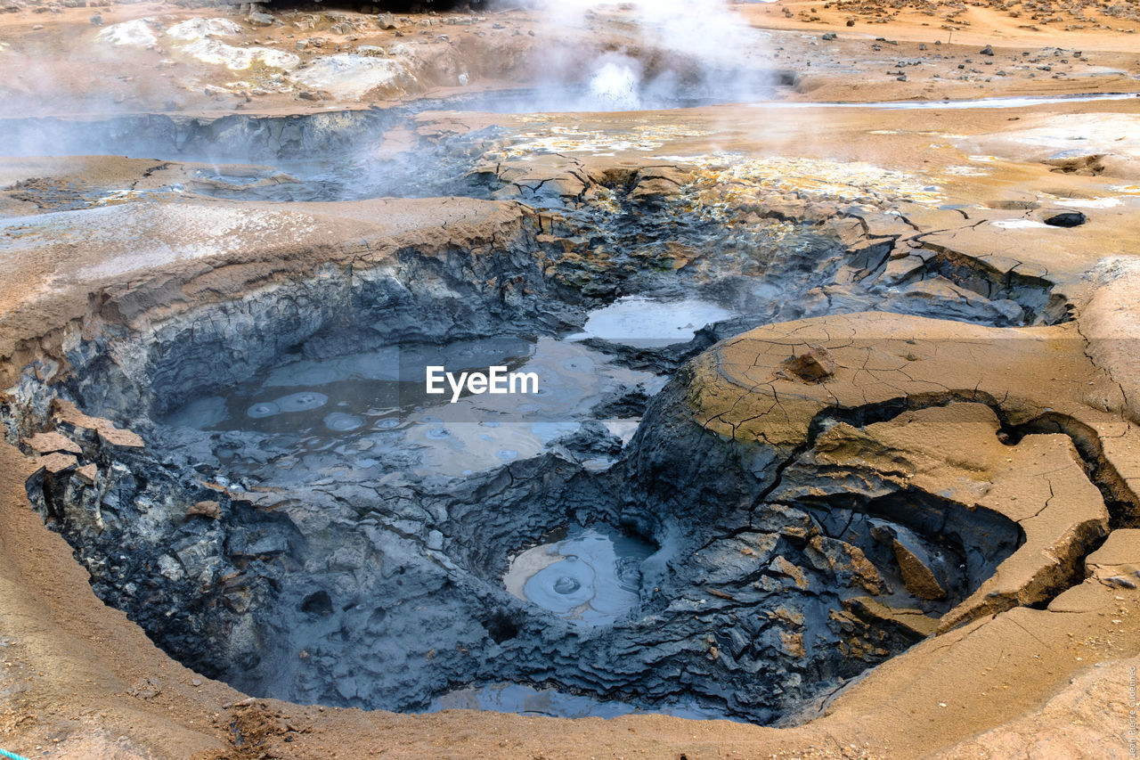 High Angle View Of Steam Emitting From Mud Pots At Hverir