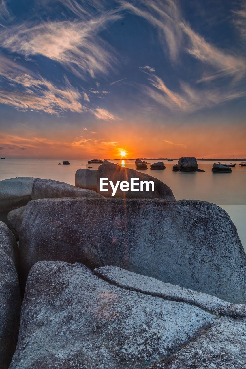 sky, sunset, water, cloud - sky, scenics - nature, rock, beauty in nature, sea, nature, tranquil scene, solid, rock - object, tranquility, no people, sun, beach, land, idyllic, outdoors