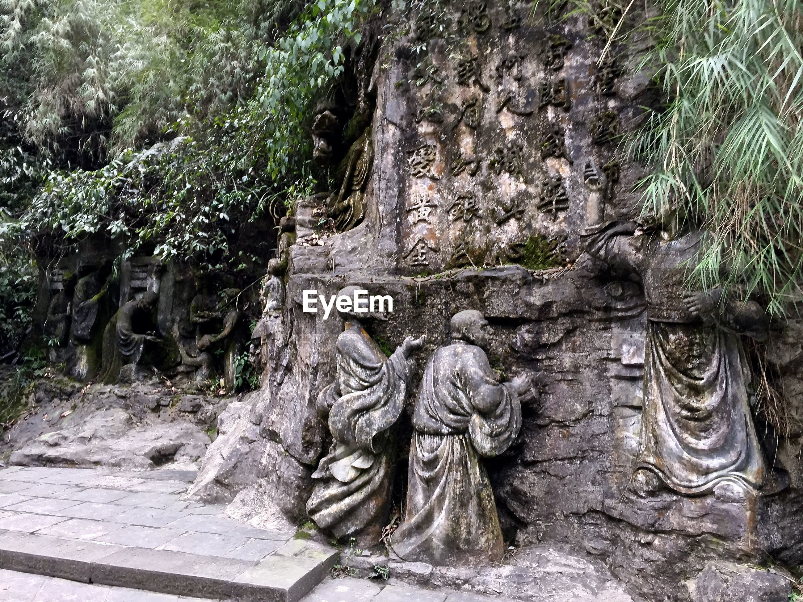 Statues by rocks at historic site