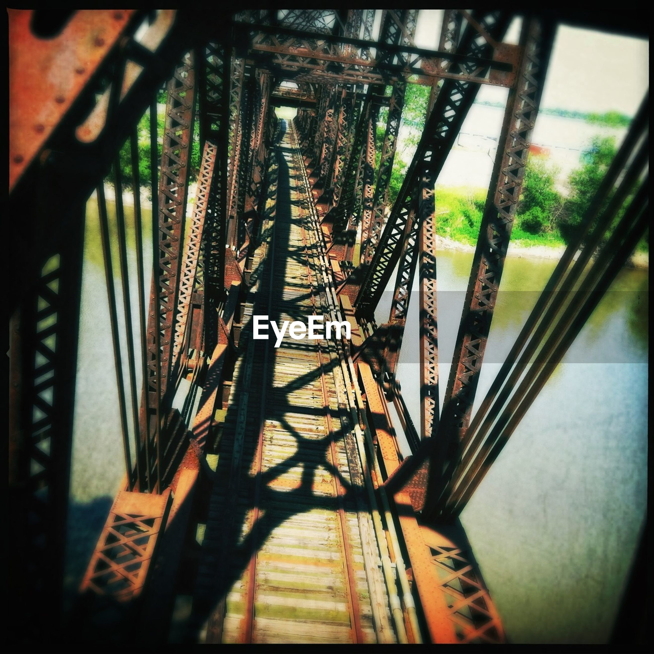 transfer print, transportation, built structure, connection, architecture, auto post production filter, metal, bridge - man made structure, the way forward, indoors, diminishing perspective, low angle view, engineering, railroad track, rail transportation, no people, railing, day, metallic, bridge