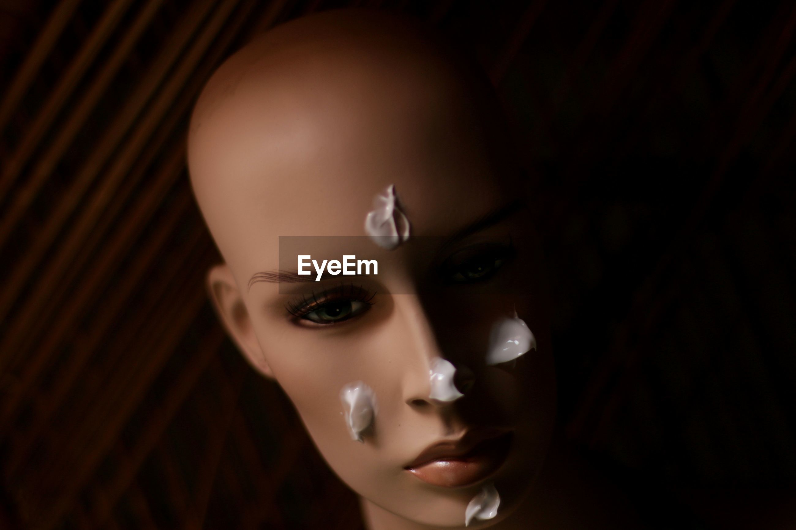 Close-up of cream on mannequin face