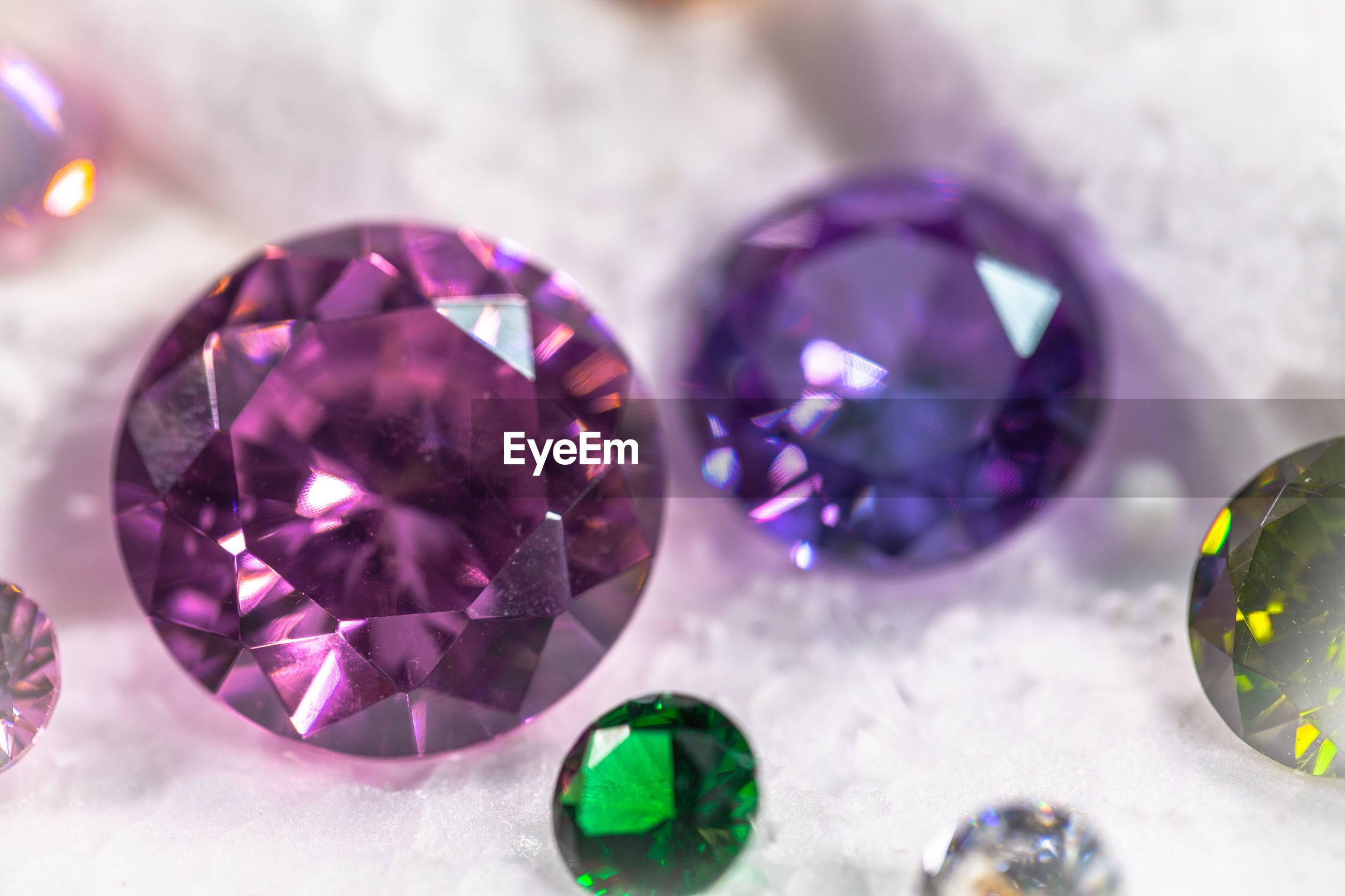 Close-up of multi colored gemstones on table