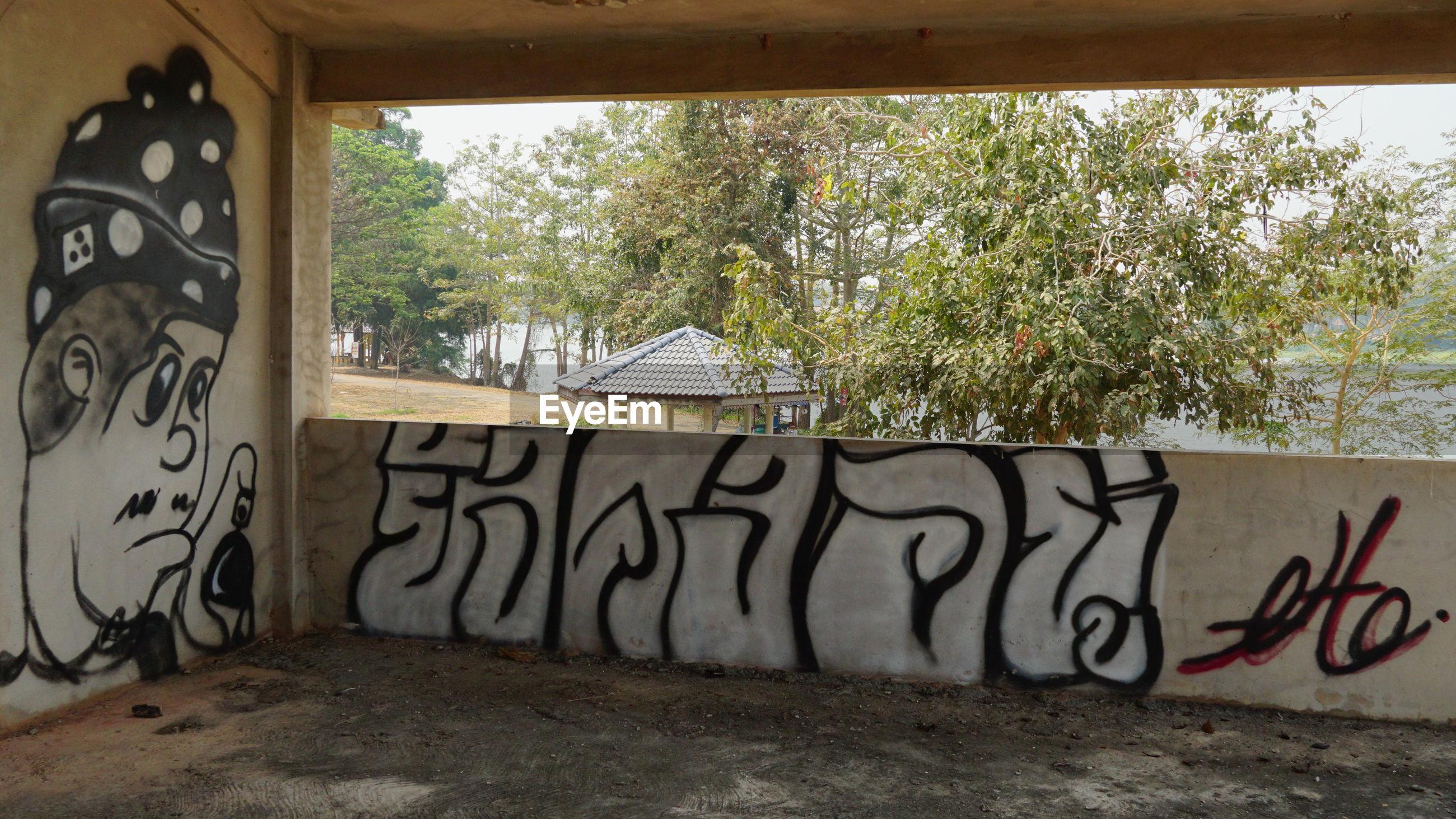 GRAFFITI ON WALL BY WINDOW