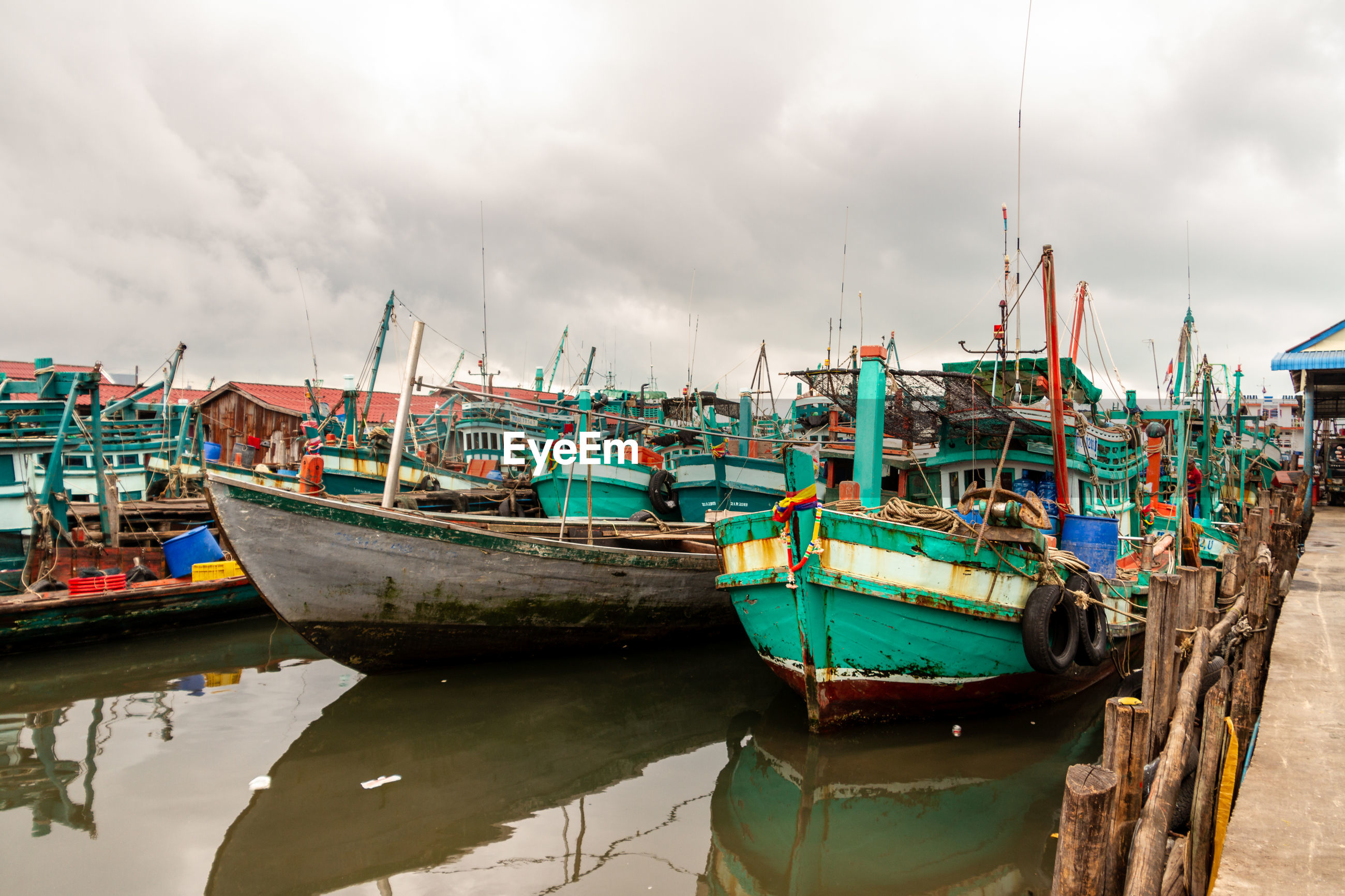 FISHING BOATS MOORED AT HARBOR