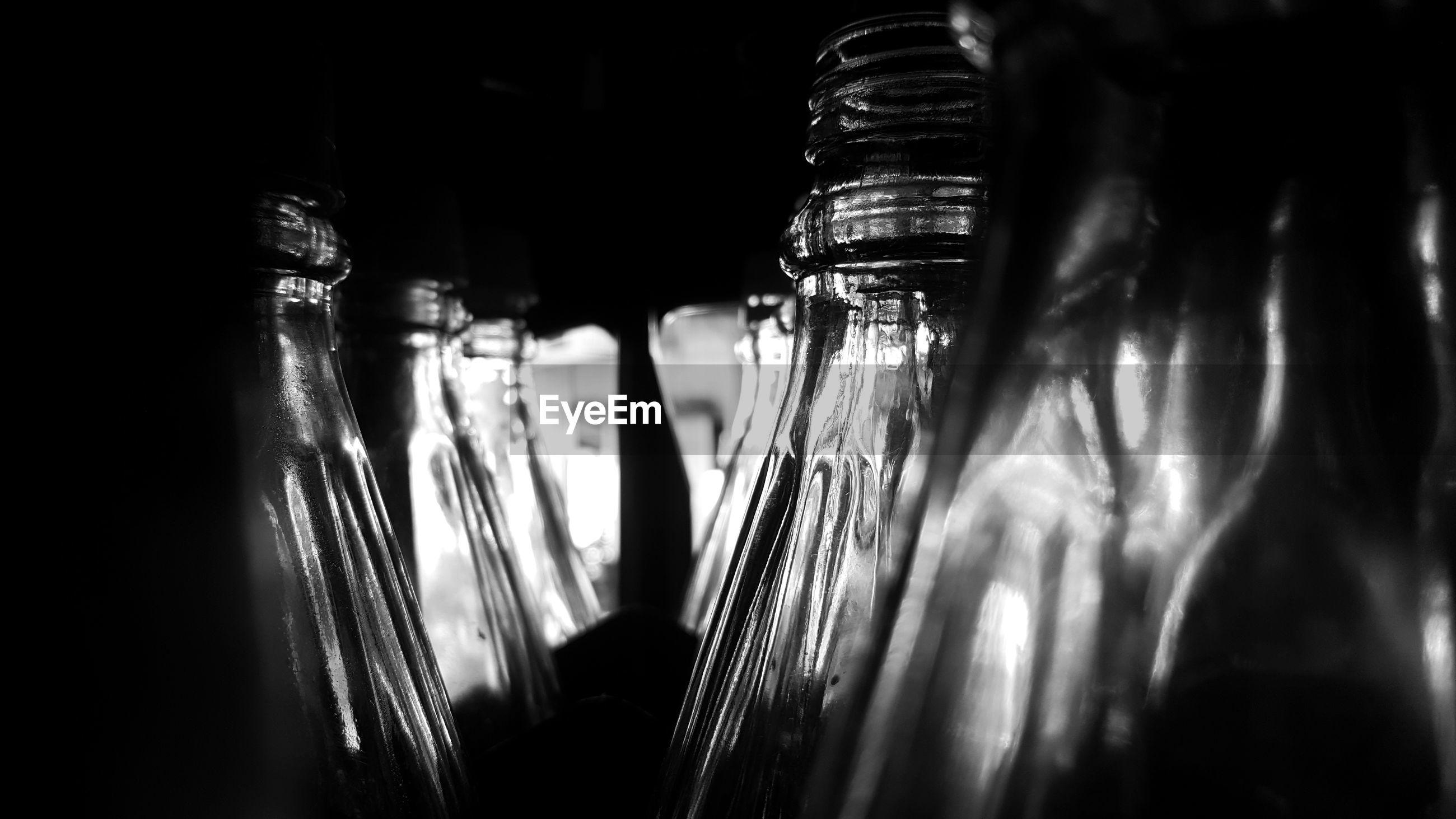 Close-up of bottles in darkroom