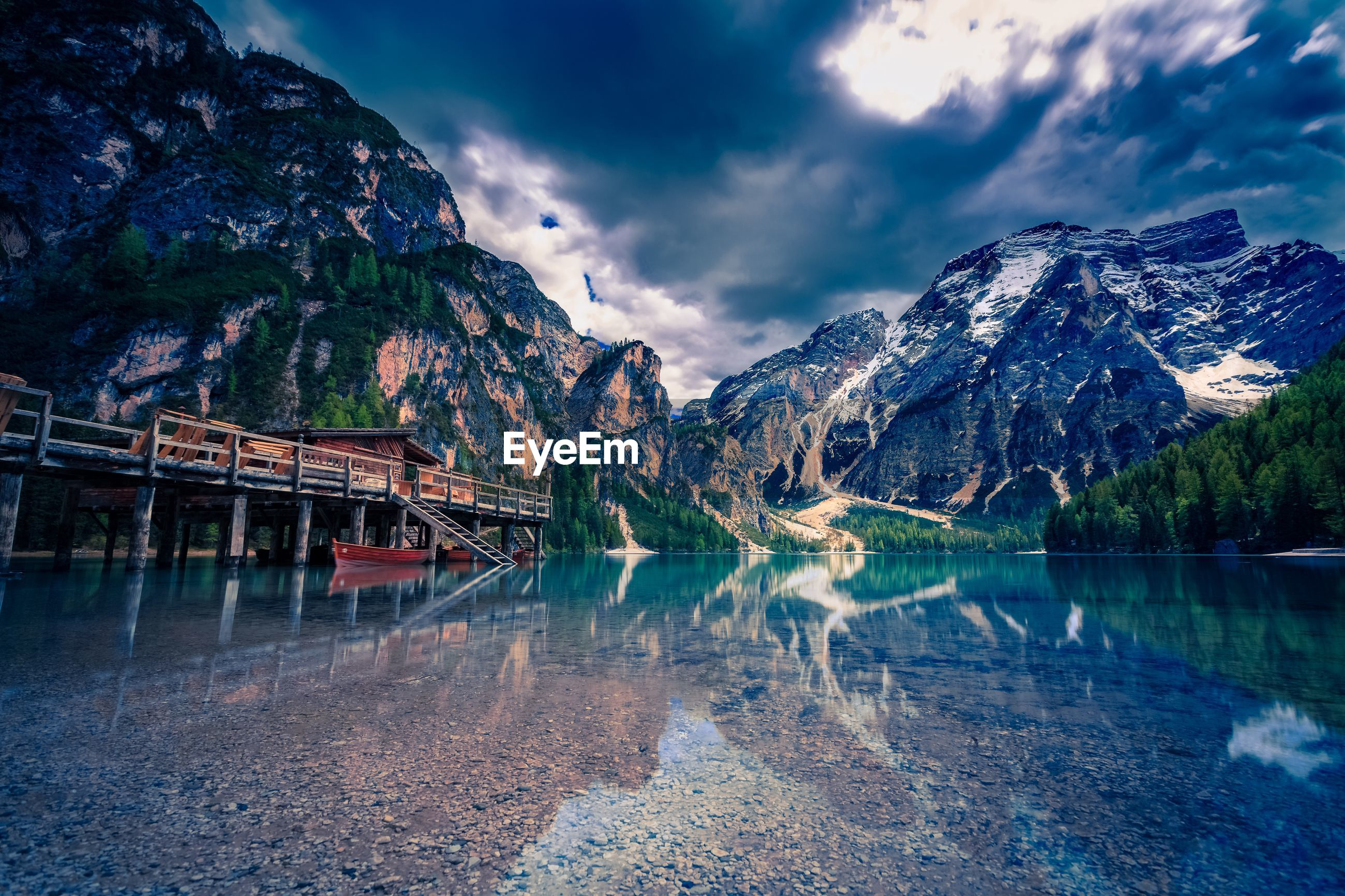 Scenic view of lake braies by mountains against sky