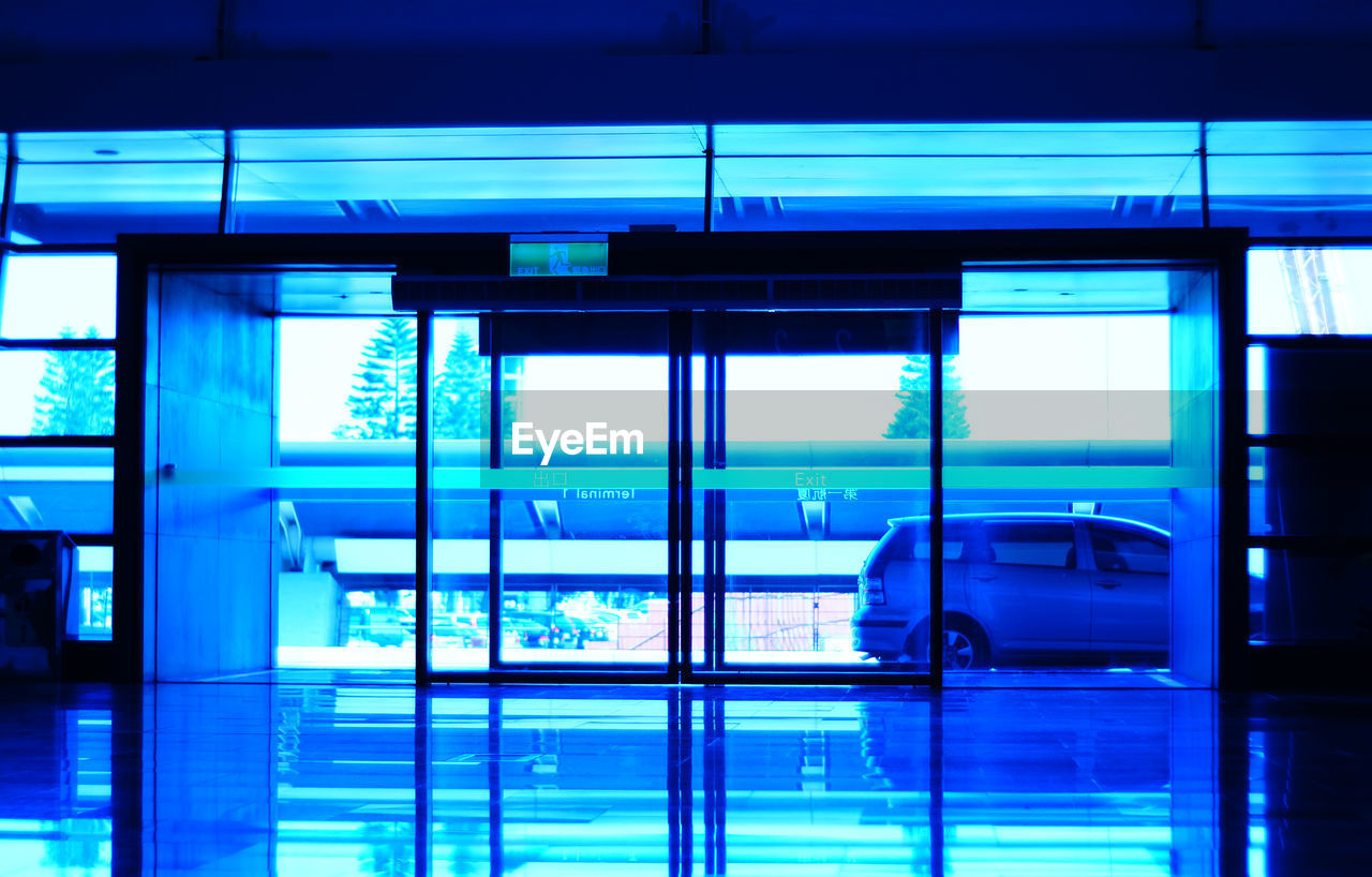 window, architecture, blue, indoors, modern, built structure, no people, transportation, day, business, technology, city