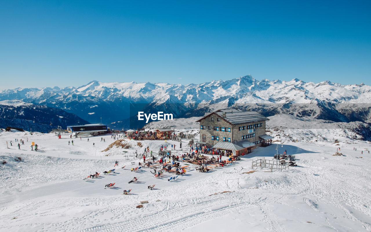 VIEW OF SKI LIFT AGAINST MOUNTAIN