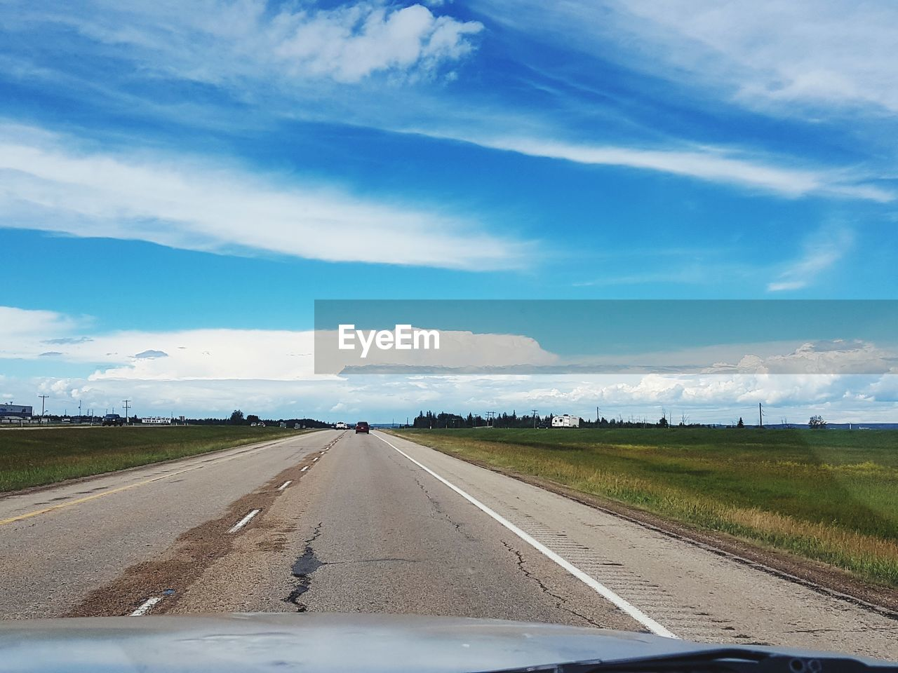 sky, transportation, cloud - sky, road, car, land vehicle, vehicle interior, mode of transportation, motor vehicle, windshield, nature, glass - material, direction, no people, transparent, diminishing perspective, the way forward, car interior, non-urban scene, environment, car point of view, road trip
