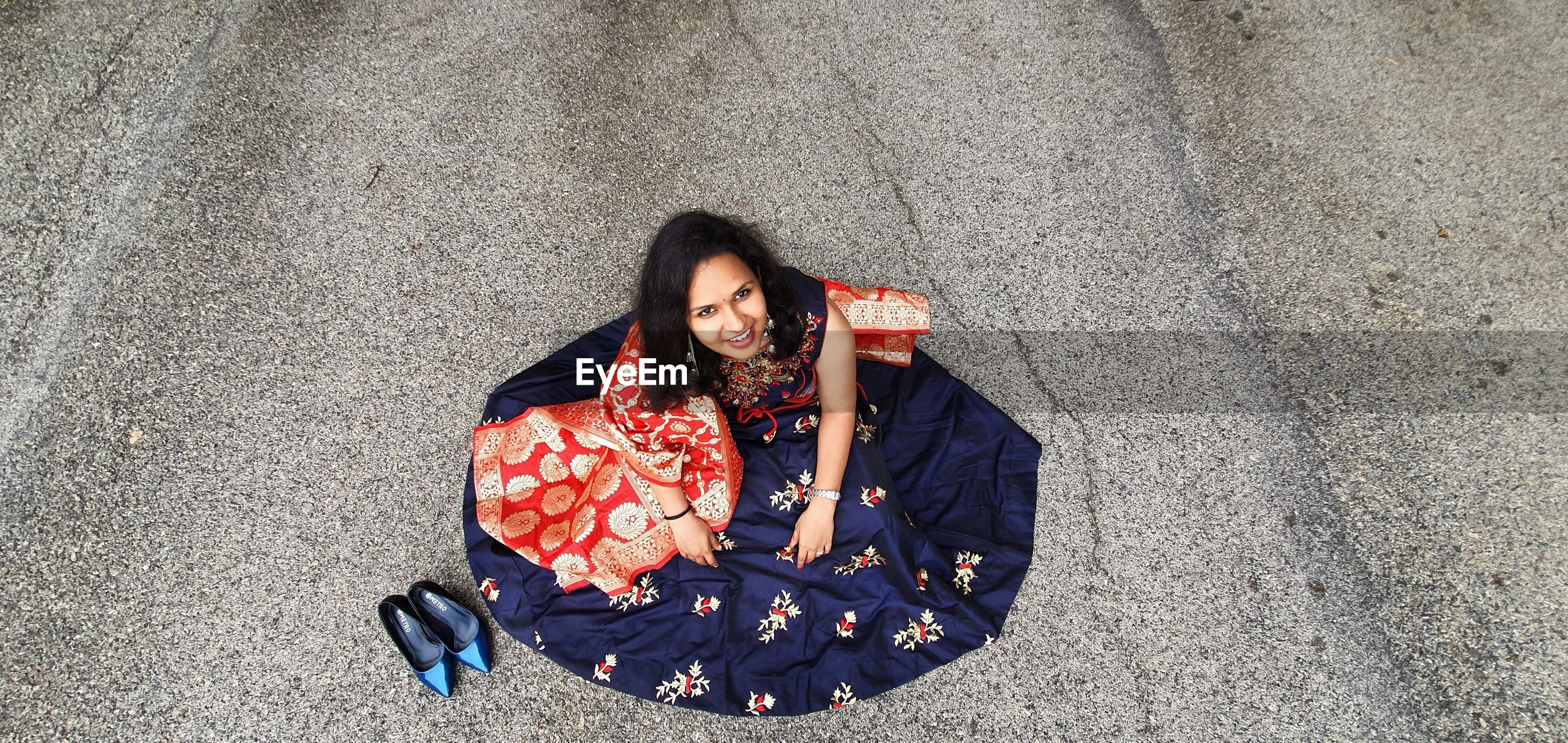 High angle view of woman sitting