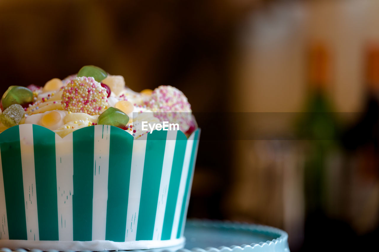 sweet food, food and drink, indulgence, focus on foreground, indoors, temptation, table, pink color, no people, close-up, food, cupcake, unhealthy eating, freshness, dessert, ready-to-eat, day
