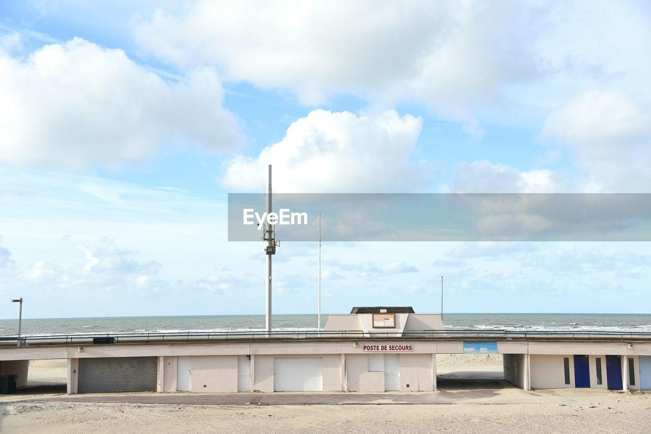 cloud - sky, sky, sea, built structure, day, architecture, beach, no people, water, building exterior, outdoors, nature, scenics, horizon over water, sand, beauty in nature, technology